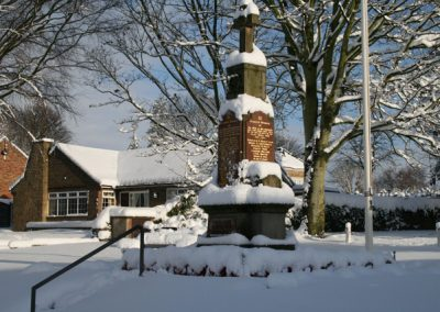 A view of the War Memorial partly covered in snow