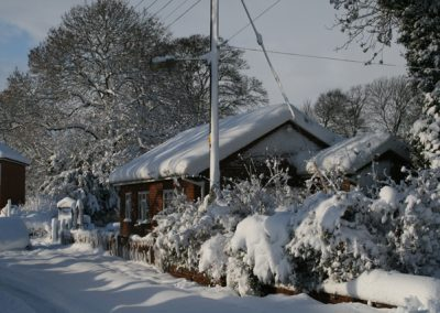 A view of a local bungalow covered in snow