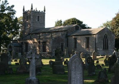 A view of the churchyard with the church to the rear