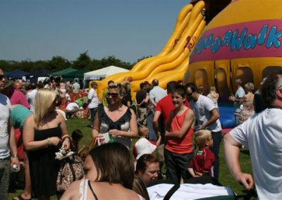 Visitors to Messingham Show by a bouncy castle