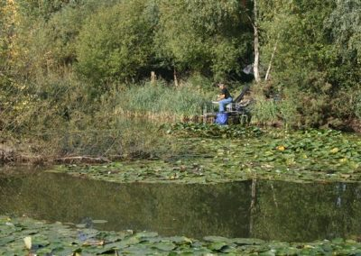 An angler on the bank of the lake in the nature reserve near Messingham