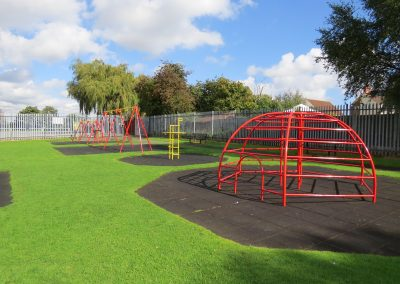 Children's play area with swings and climbing frames
