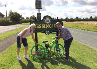 A bike decorated for the Tour of Britain by the Messingham road sign