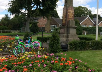 A bike decorated for the Tour of Britain in the Messingham memorial garden